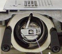 Качающийся челнок в швейной машине