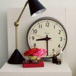 Vintage-clock-decorating-a-modern-bedside-table
